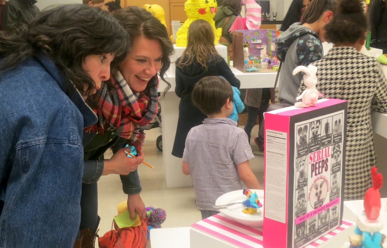 Two women looking at Peeps Art Show 2017